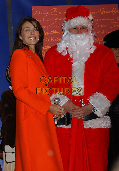 ELIZABETH HURLEY.guest of honour with Father Christmas.at the switching on of Christmas lights .in Cirencester, Gloucestershire.21/11/2003 .liz, santa claus.sales@capitalpictures.com.www.capitalpictures.com.©Capital Pictures