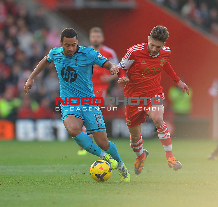 Tottenham Hotspur's Mousa Dembele battles for the ball with Southampton's Adam Lallana -  22/12/2013 - SPORT - FOOTBALL - St Mary's Stadium - Southampton - Southampton v Tottenham Hotspur - Barclays Premier League<br /> Foto nph / Meredith<br /> <br /> ***** OUT OF UK *****