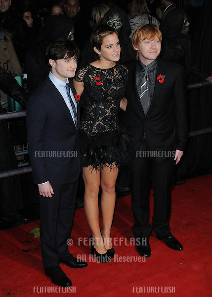 Daniel Radcliffe, Emma Watson and Rupert Grint  attends the world premiere of 'Harry Potter and The Deathly Hallows' at Odeon Leicester Square in London..November 11, 2010  London, UK.Picture: Anne-Marie Michel / Featureflash