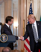 United States President Donald J. Trump, right, and Prime Minister Giuseppe Conte of Italy, left, shake hands during a joint press conference in the East Room of the White House in Washington, DC on Monday, July 30, 2018.<br /> Credit: Ron Sachs / CNP