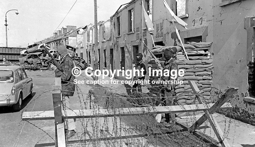 Provisional IRA members have set up a sandbag emplacement and checkpoint to regulate foot and vehicle traffic into and out of Free Derry, essentially the Bogside area of Londonderry. May 1972. 197205000294c<br /> <br /> Copyright Image from Victor Patterson, 54 Dorchester Park, Belfast, UK, BT9 6RJ<br /> <br /> Tel: +44 28 9066 1296<br /> Mob: +44 7802 353836<br /> Voicemail +44 20 8816 7153<br /> Email: victorpatterson@me.com<br /> Email: victorpatterson@gmail.com<br /> <br /> IMPORTANT: My Terms and Conditions of Business are at www.victorpatterson.com