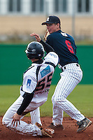 16 October 2010: Anthony Piquet of Rouen throws the ball to first base for a double play during Rouen 16-4 win over Savigny, during game 1 of the French championship finals, in Savigny sur Orge, France.