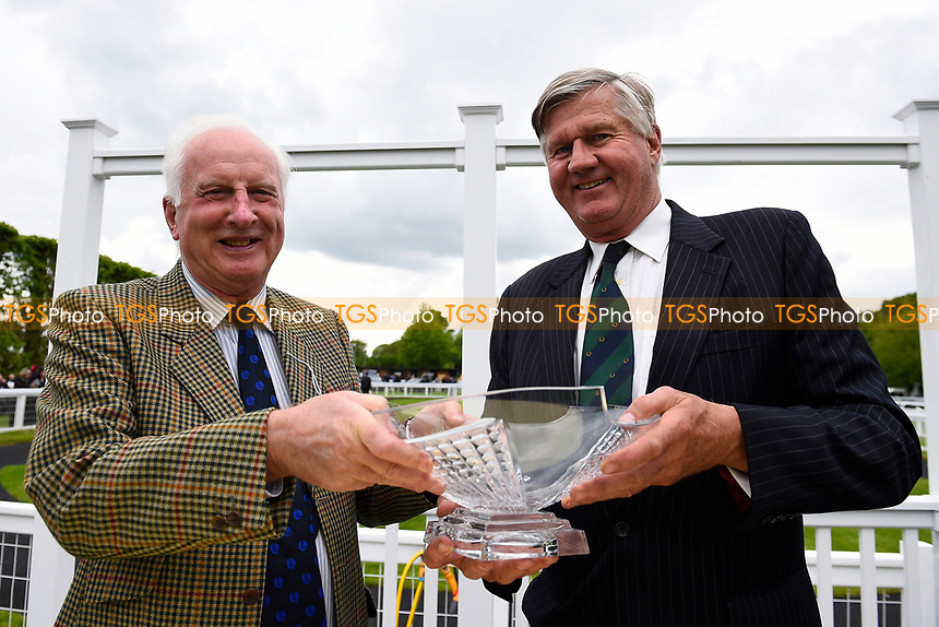 Connections of Scorching Heat receive their trophy during Afternoon Racing at Salisbury Racecourse on 18th May 2017