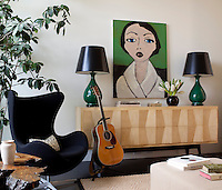 An Arne Jacobsen Egg chair is placed alongside a retro sideboard in the sitting room