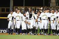 Bradenton Marauders outfielder Raul Fortunato (35 - shirt open) walks off the field after being mobbed by teammates including Max Moroff (31), Jhondaniel Medina (34), Eric Wood (48) after the game winning hit during a game against the Palm Beach Cardinals on April 8, 2014 at McKechnie Field in Bradenton, Florida.  Bradenton defeated Palm Beach 4-3.  (Mike Janes/Four Seam Images)