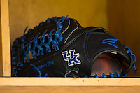 The glove of Kentucky Wildcats pitcher Zack Thompson (14) sits in the visitors dugout prior to the game against the North Carolina Tar Heels at Boshmer Stadium on February 17, 2017 in Chapel Hill, North Carolina.  The Tar Heels defeated the Wildcats 3-1.  (Brian Westerholt/Four Seam Images)