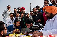 FARIDKOT, PUNJAB, INDIA - JANUARY 05, 2016: A commentator calls a race as punters look on during a greyhound race meet on January 5, 2016 in Faridkot, India. <br /> Daniel Berehulak for The New York Times