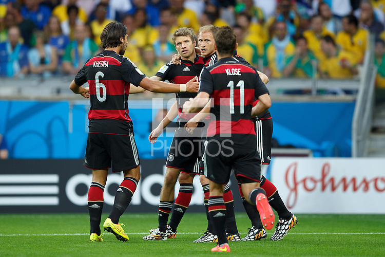 Thomas Muller of Germany celebrates scoring a goal with team mates after making it 0-1
