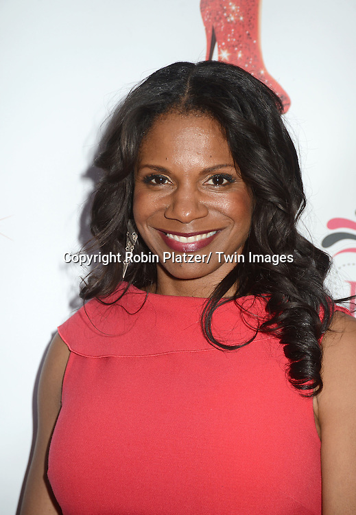 "Audra McDonald arrives at the ""Kinky Boots"" Broadway Opening on April 4, 2013 at The Al Hirschfeld Theatre in New York City. Harvey Fierstein wrote is the Book Writer and Cnydi Lauper is the Composer."