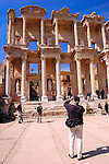 Tourist photographing Library of Celsus, Ephesus, Turkey