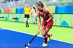 Katie Reinprecht #14 of United States carries the ball up the field during USA vs Japan in a Pool B game at the Rio 2016 Olympics at the Olympic Hockey Centre in Rio de Janeiro, Brazil.