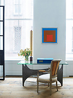 In the library, a 1966 table by Philippe Hiquily is paired with a Louis XVI fauteuil with its original upholstery; the painting is by Josef Albers.