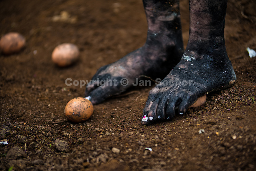 Diana R., who claims to be possessed by spirits, steps on eggs during a ritual of exorcism performed by Hermes Cifuentes in La Cumbre, Colombia, 28 May 2012. Exorcism is an ancient religious practice of evicting spirits, generally called demons or evil. Although the formal catholic rite of exorcism is rarely seen and must be only conducted by a designated priest, there are many pastors and preachers in Latin America performing exorcism ceremonies. The 52-year-old Brother Hermes, as the exorcist calls himself, claims to have been carrying out the healing rituals for more than 20 years. Using fire, dirt, candles, flowers, eggs and other natural-based items, in conjunction with Christian religous formulas, he attempts to drive the supposed evil spirit out of a victim's mind and body.