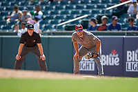 Lehigh Valley IronPigs first baseman Damek Tomscha (13) holds a runner on as umpire Richard Riley looks on during an International League game against the Buffalo Bisons on June 9, 2019 at Sahlen Field in Buffalo, New York.  Lehigh Valley defeated Buffalo 7-6 in 11 innings.  (Mike Janes/Four Seam Images)