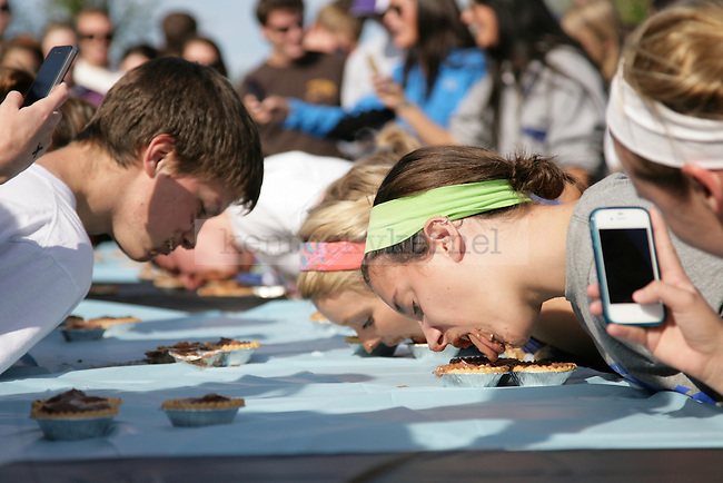 Fraternity and Sorority members eat small pudding pies during a pudding pie eating contest at the  17th annual PiAthon Thursday, April 5, 2012 at Good Barn field in Lexington, Ky. Photo by Brandon Goodwin | Staff