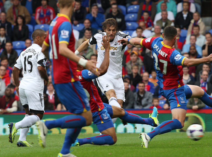 Swansea City's Michu Scores first goal<br /> <br /> Photo by Kieran Galvin/CameraSport<br /> <br /> Football - Barclays Premiership - Crystal Palace v Swansea City - Sunday 22nd September 2013 - Selhurst Park - London<br /> <br /> &copy; CameraSport - 43 Linden Ave. Countesthorpe. Leicester. England. LE8 5PG - Tel: +44 (0) 116 277 4147 - admin@camerasport.com - www.camerasport.com