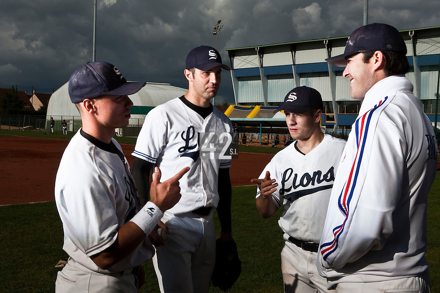10 october 2009: From left to right, Yann Dal Zotto, Sebastien Boyer, Thomas Salado and Tim Stewart are seen prior to game 3 of the 2009 French Elite Finals won 4-2 by Savigny over Rouen, at Stade Jean Moulin stadium in Savigny sur Orge, near Paris, France.