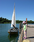 Child and Sailboat in Turku Archipelago, Finland