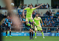 Michael Woods of Hartlepool United commits a foul as he beats Luke O'Nien of Wycombe in the air during the Sky Bet League 2 match between Wycombe Wanderers and Hartlepool United at Adams Park, High Wycombe, England on 5 September 2015. Photo by Andy Rowland.