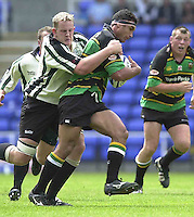 19/05/2002.Sport -Rugby Union- Zurich Championship Quarter final.London Irish v Northampton.Exiles Kevin Burke hangs on to Saints breaking Andrew Blowers...[Mandatory Credit, Peter Spurier/ Intersport Images].