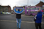 "Portsmouth fans waving and gesturing to rival Southampton fans in a convoy of buses driving away from Fratton Park stadium after the teams Championship fixture against their local rivals. Around 3000 away fans were taken directly to the game in a fleet of buses in a police operation known as the ""coach bubble"" to avoid the possibility of disorder between rival fans. The match ended in a one-all draw watched by a near capacity crowd of 19,879."