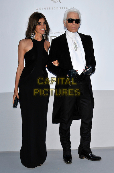 Carine Roitfeld, Karl Lagerfeld.AmFAR Cinema Against AIDS 2012, Hotel du Cap, Antibes during the 65th  Cannes Film Festival, France..24th May 2012.full length black dress suit sunglasses shades .CAP/PL.©Phil Loftus/Capital Pictures.