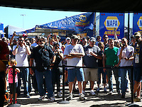Sept. 21, 2013; Ennis, TX, USA: Fans gather at the pits of an NHRA top fuel dragster team during the Fall Nationals at the Texas Motorplex. Mandatory Credit: Mark J. Rebilas-