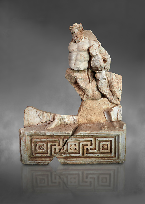 Roman Sebasteion relief  sculpture of Herakles or Hercules Drunk Aphrodisias Museum, Aphrodisias, Turkey.  Against a grey background.<br /> <br /> Herakles or Hercules staggers along drunk, supported by a small satyr from the entourage of Dionysus. He is wearing the head ribbon of a drinking party, where he has been in a drinking contest with Dionysus. The wine god has conquered even the mighty hero of the Twelve Labours.