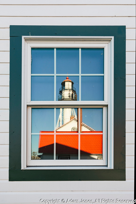 Whitefish Point Lighthouse reflected in window, the oldest operating light on Lake Superior, Upper Peninsula, Michigan
