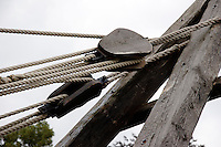 SIMPLE MACHINE<br /> Roman Ruins Site, Aalen Switzerland<br /> Closeup of the pulleys which trade force for distance.