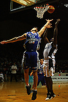 Nick Horvath leaps to try and block Giants forward Jamil Terrell during the NBL Semifinal basketball match between the Wellington Saints and Nelson Giants at TSB Bank Arena, Wellington, New Zealand on Thursday, 12 June 2008. Photo: Dave Lintott / lintottphoto.co.nz