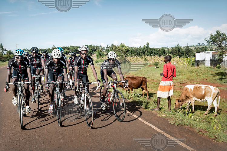 The Kenyan Riders, a Kenyan cycling team, train along the road between Eldoret and Iten, a small town in the highlands on the edge of the Great Rift Valley at an altitude of 2400 metres, a perfect location for high altitude training. The team is managed by Singaporean Nicholas Leong and trained by Australian Simon Blake.