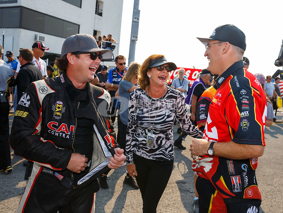 Sep 4, 2017; Clermont, IN, USA; NHRA top fuel driver Steve Torrence (left) with mother Kay Torrence (center) and Doug Kalitta during the US Nationals at Lucas Oil Raceway. Mandatory Credit: Mark J. Rebilas-USA TODAY Sports