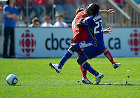 05 June 2010: Toronto FC defender Nick Garcia #4 collides with Kansas City Wizards forward Kei Kamara #23 during a game between the Kansas City Wizards and Toronto FC at BMO Field in Toronto..The game ended in a 0-0 draw.