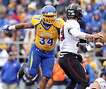 BROOKINGS, SD - OCTOBER 5:  Doug Peete #34 from South Dakota State University pursues quarterback Kory Faulkner #19 from Southern Illinois in the first quarter Saturday afternoon at Coughlin Alumni Stadium in Brookings. (Photo by Dave Eggen/Inertia)