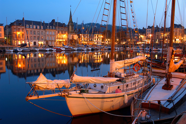 night harbour scene with lights of yaughts and harbour restaurants. Honfleur, Normandy, France.