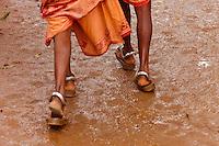 Gond tribe women wear heavy alloy rings at their ankles, Lohandiguda, Chhattisgarh, India