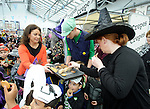 Fiona Whelan giving out goodies during a public performance in the Market by the Ennis Holy Family school pupils before the annual  Clare Champion Halloween Party. Photograph by John Kelly.