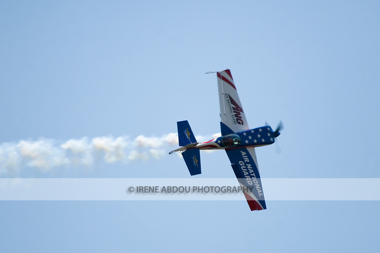A plane performs aerobatics at the Andrews Air Force Base, Maryland, during the 2008 Joint Service Open House air show.