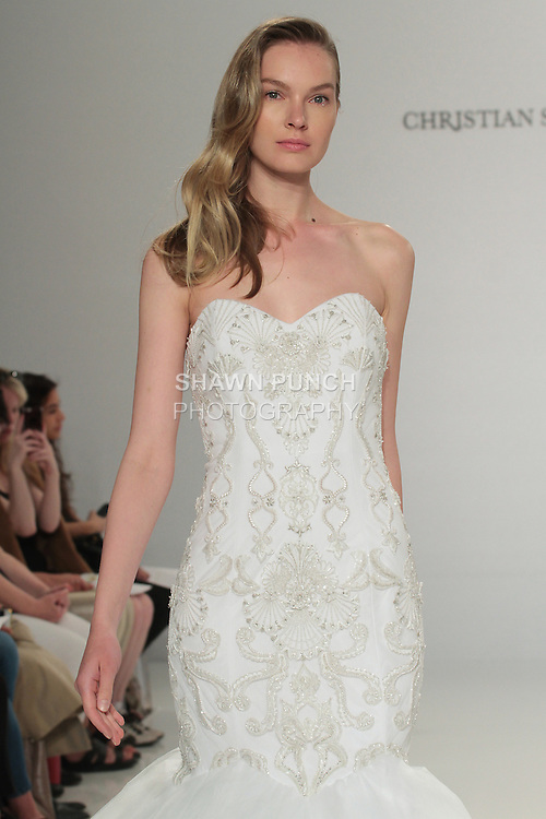 Model walks runway in an embroidered strapless mermaid gown, from the Christian Siriano for Kleinfeld bridal collection, at Kleinfeld on April 18, 2016 during New York Bridal Fashion Week Spring Summer 2017.