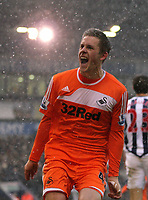 Pictured: Gylfi Sigurdsson of Swansea celebrating his equaliser. Saturday, 04 February 2012<br />