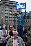 A boy holding a 'Yes' sign aloft in a crowd at a pro-independence gathering in George Square, Glasgow. The gathering brought together Yes Scotland supporters who favour Scotland leaving the union with the United Kingdom. On the 18th of September 2014, the people of Scotland voted in a referendum to decide whether the country's union with England should continue or Scotland should become an independent nation once again and leave the United Kingdom.
