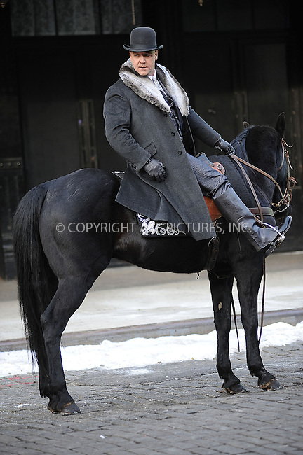 WWW.ACEPIXS.COM . . . . . .December 12, 2012...New York City....Russell Crowe ride horses on the film set ' Winter's Tale' in the Meatpacking District on December 12, 2012 in New York City ....Please byline: KRISTIN CALLAHAN - ACEPIXS.COM.. . . . . . ..Ace Pictures, Inc: ..tel: (212) 243 8787 or (646) 769 0430..e-mail: info@acepixs.com..web: http://www.acepixs.com .