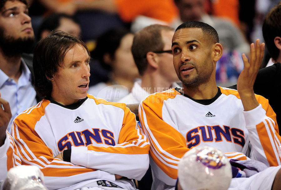 Nov. 11, 2009; Phoenix, AZ, USA; Phoenix Suns guard Steve Nash (left) and forward Grant Hill sit on the bench in the fourth quarter against the New Orleans Hornets at the US Airways Center. Phoenix defeated New Orleans 124-104. Mandatory Credit: Mark J. Rebilas-