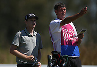 Caddie Steve shows Kevin Phelan (IRL) the way to a round of 69 (-7) during Round Two of The Tshwane Open 2014 at the Els (Copperleaf) Golf Club, City of Tshwane, Pretoria, South Africa. Picture:  David Lloyd / www.golffile.ie