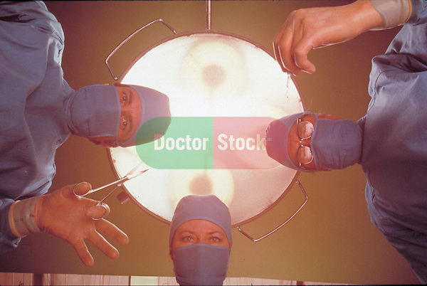 three surgeons operating