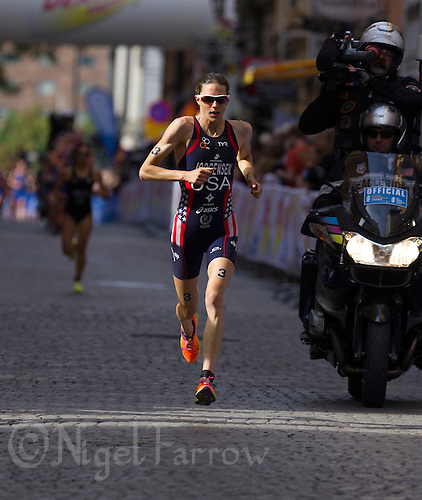 24 AUG 2013 - STOCKHOLM, SWE - Gwen Jorgensen (USA) of the USA leads the run at the elite women's ITU 2013 World Triathlon Series round in Gamla Stan, Stockholm, Sweden (PHOTO COPYRIGHT © 2013 NIGEL FARROW, ALL RIGHTS RESERVED)