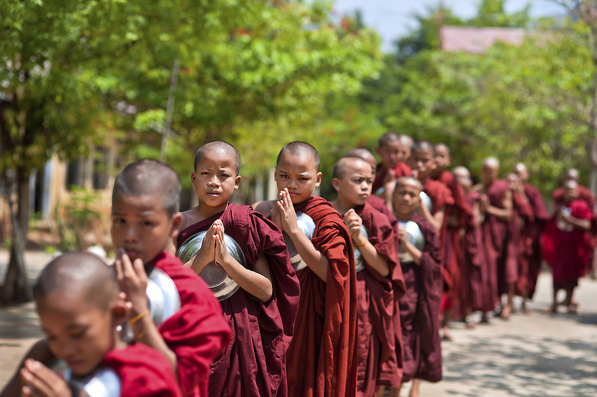 Novice monks line up before taking their lunch at Thita Sa Waita Gu monastery where Head Abbott U Kamasara teaches his devotees about the growing threat of Muslims trying to convert the country to Islam.  U Kamasara started the monastery, located about 10 km outside of Mandalay, as a small meditation centre. But in the last year it has grown to include several large buildings; another is currently in the works. His devotees, who can become monks in as little as 2 weeks, make regular trips across the country to preach the 969 message.