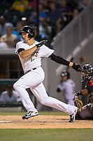 Trayce Thompson (15) of the Charlotte Knights follows through on his swing against the Indianapolis Indians at BB&T BallPark on June 20, 2015 in Charlotte, North Carolina.  The Knights defeated the Indians 6-5 in 12 innings.  (Brian Westerholt/Four Seam Images)