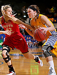 BROOKINGS, SD - FEBRUARY 21:  Megan Waytashek #34 from South Dakota State takes drives past Heidi Hoff #42 from the University of South Dakota in the first half of their game Saturday evening at Frost Arena in Brookings. (Photo by Dave Eggen/Inertia)